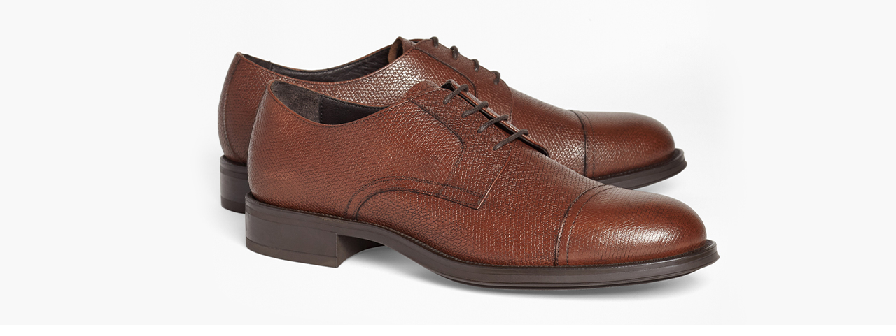 The 1818 Footwear Collection The Captoe Our signature take on the classic captoe, cast in richly textured Italian leather