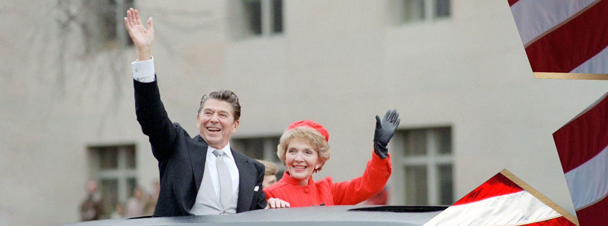 President Reagan and Nancy Reagan waving from the limousine during the Inaugural Parade in Washington DC. 1/20/1981