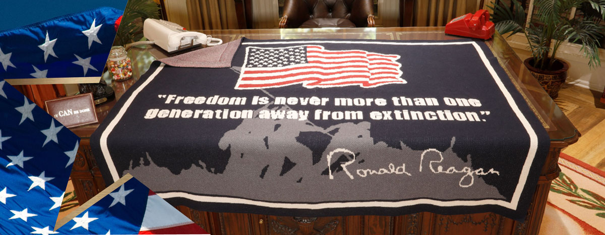 """Ronald Reagan """"Freedom Blanket"""" on the desk of the Reagan library Discovery Center's Oval Office."""