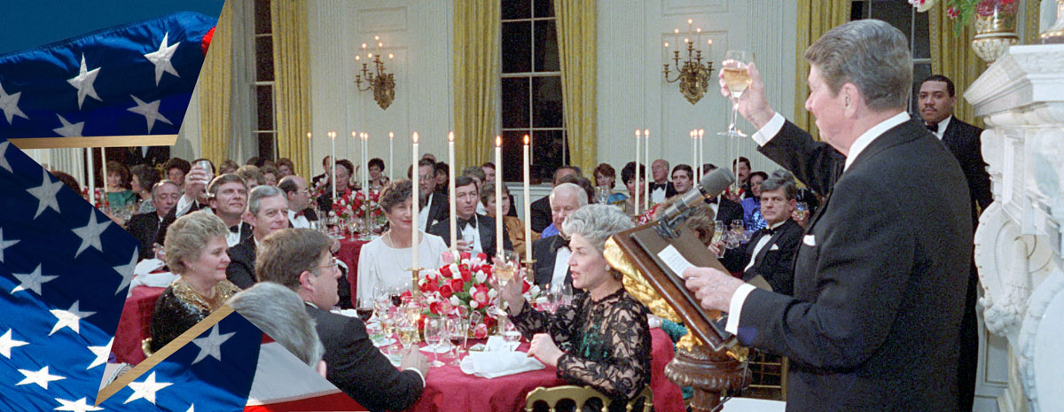 President Reagan making a toast and speaking at the podium at a White House dinner.