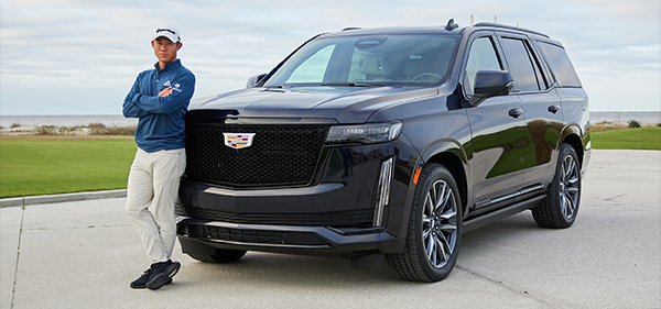 PGA Tour Pro Collin Morikawa leaning against the 2021 Escalade with his arms crossed