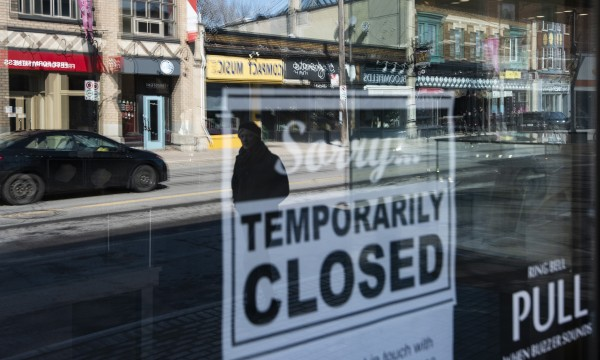 [Image of a store that is closed due to COVID-19]
