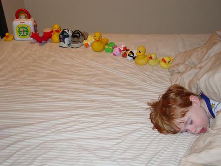 Autistic Boy Arranging Toys