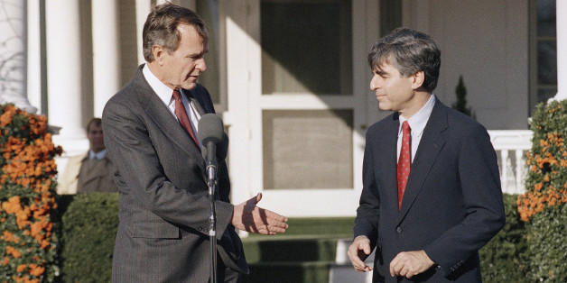 President-elect George Bush offers his hand to Massachusetts Gov. Michael Dukakis after the two met at Bush?s residence in Washington, Friday, Dec. 2, 1988. (AP Photo/Scott Applewhite)