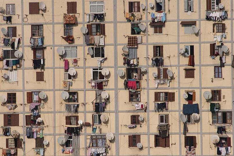 Photographer Manuel Alvarez Diestro photography series of morocco, algeria and egypt adhering to the facades or located on the roofs of buildings, satellite dish antenna