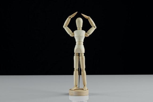 Wooden sculpture of a human body dancing