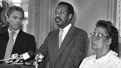 A federal court jury in Mobile, Ala., awarded Beulah May Donald $7 million in damages from the United Klans of America Inc., Feb. 12, 1987. Two Klan members murdered Mrs. Donald's son, Michael Donald, 19, in 1981. Mrs. Donald is shown at a news conference after the verdict with her attorneys, State Sen. Michael Figures, center at podium, and Morris Dees, founder of the Southern Poverty Law Center in Montgomery. (AP Photo/Mobile Press-Register/Mary Hattler)