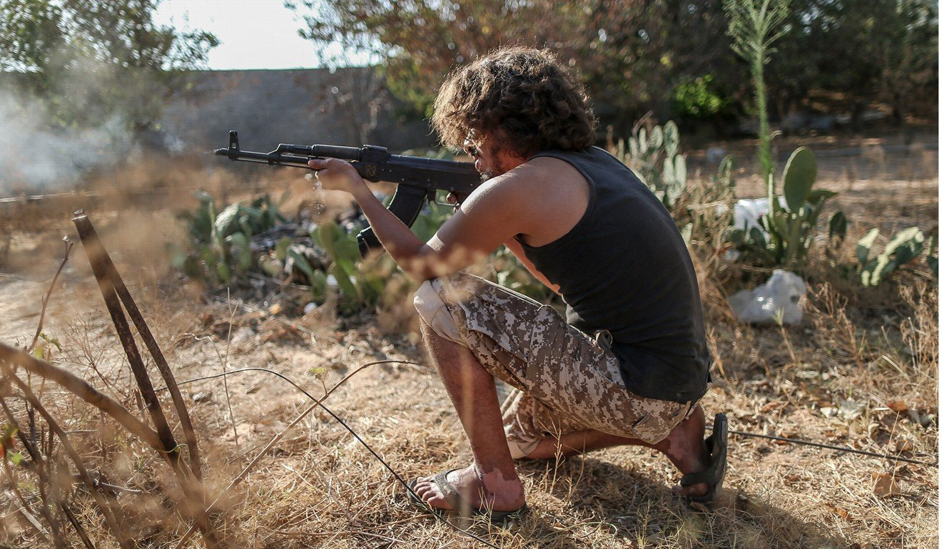 A fighter from Libya's UN-backed Government of National Accord (GNA) fires his rifle during clashes at the Al-Khalla frontline in Tripoli. File photo: TNS