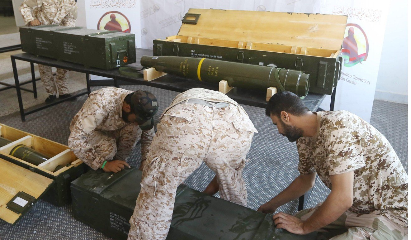 Fighters loyal to the internationally-recognised Libyan Government of National Accord (GNA) display Chinese-made shells bearing the markings of the United Arab Emirates (left side on the box), which were reportedly seized from forces loyal to Khalifa Hifter. Photo: AFP