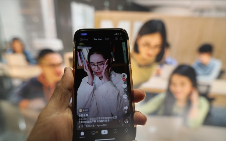 A smartphone shows live streaming of Douyin, also known as TikTok. Photo: Simon Song