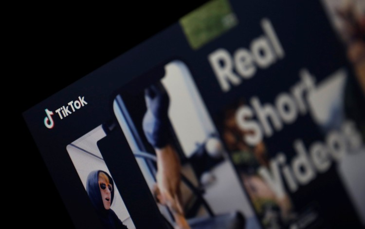 The logo of the TikTok application is seen on a screen in this picture illustration taken February 21, 2019. Photo: Reuters