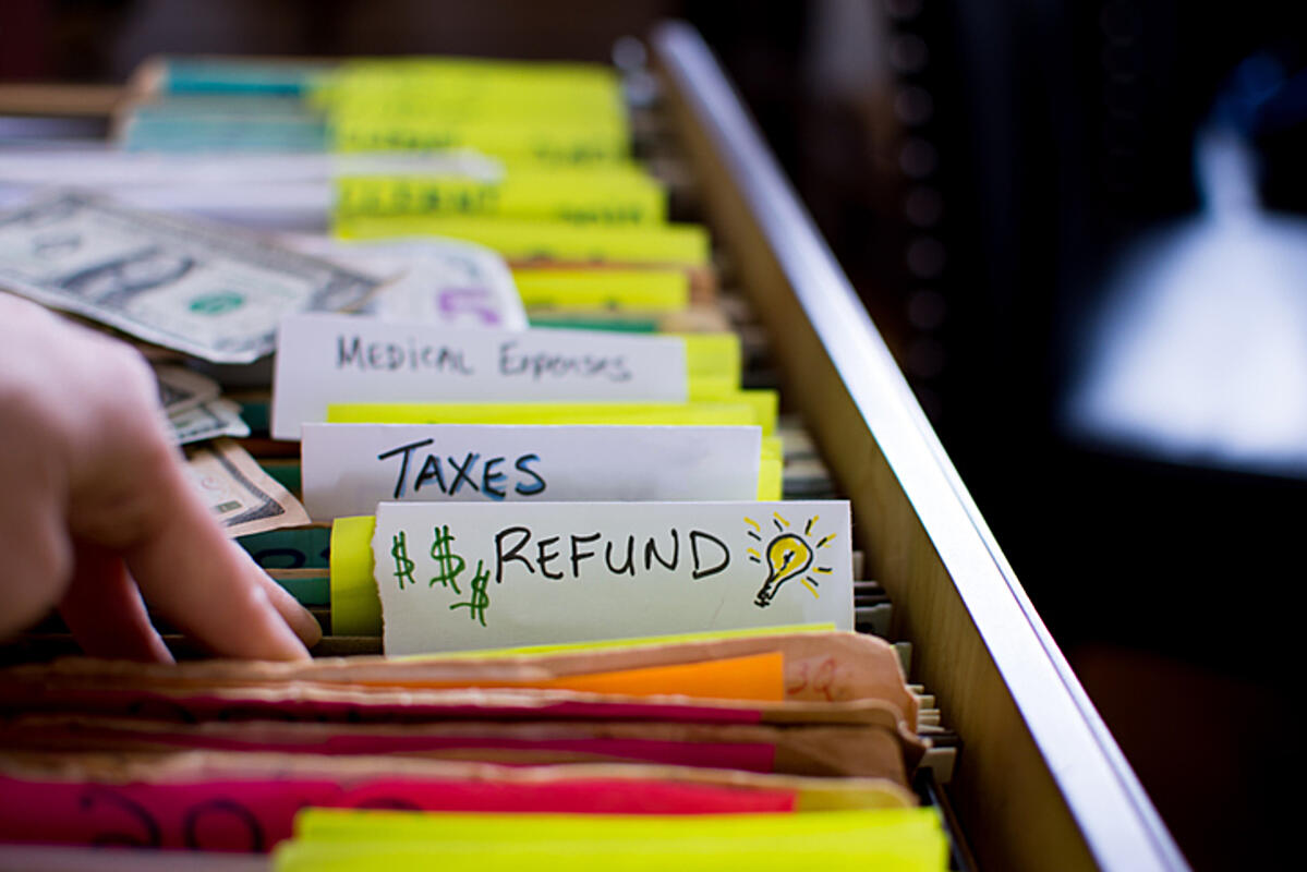 tax refund tab sticking out of a file drawer