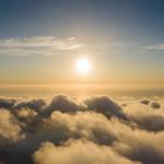 Sun over clouds