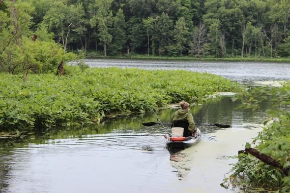 Paddler fishing at state park