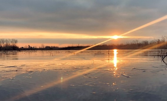 Sunrise over an icy lake