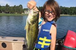 kid holding a big largemouth bass