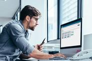 Man sitting at desk and computer