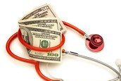 U.S. currency surrounded by a stethoscope