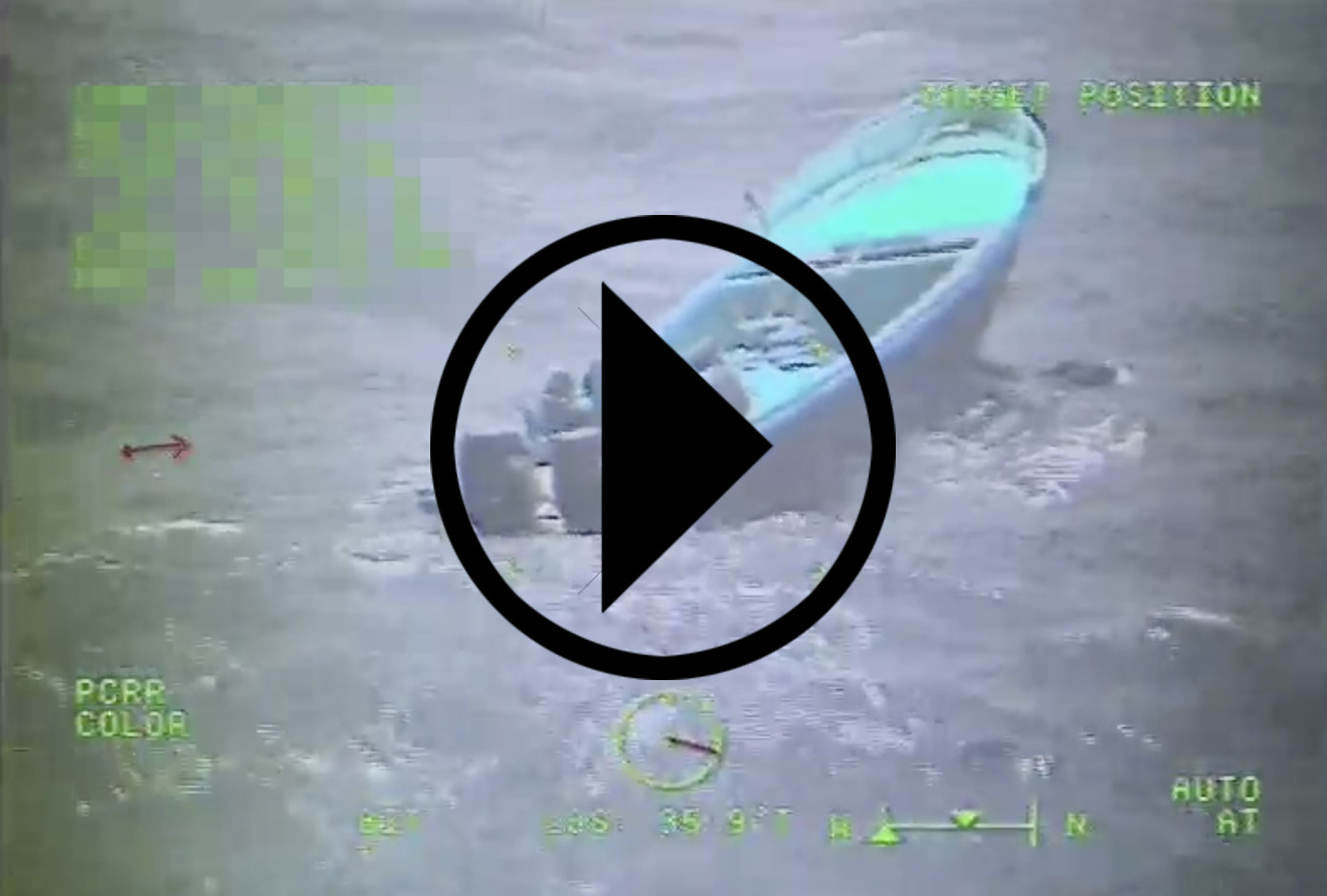 Screen shot of a Coast Guard Cutter Munro boarding team interdicting a suspected drug smuggling vessel
