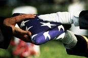 Burial, flag handover
