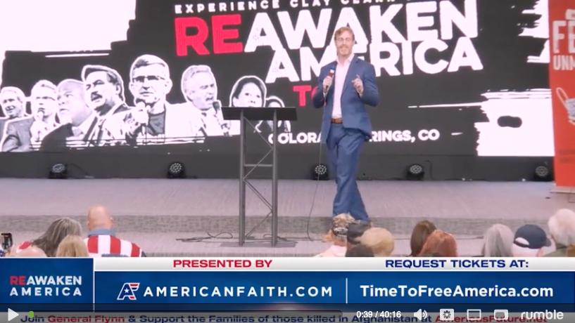 Image of Dr. Bryan Ardis speaking at REAWAKEN AMERICA TOUR