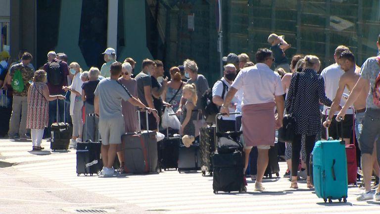 Tourists queue at Faro airport
