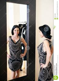 Image result for picture of woman standing in front of mirror