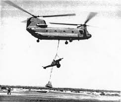 Image result for chinook with 105 mm howitzer slung below
