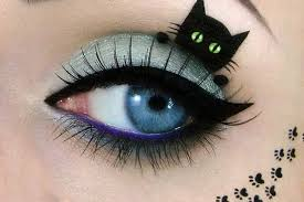 Image result for cats messing with cosmetics