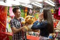 Image result for picture of a girl holding a teddy bear won at the fair