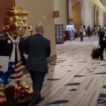 Massive golden statue of Trump holding star wand Wheeled Into Gathering ahead of speech