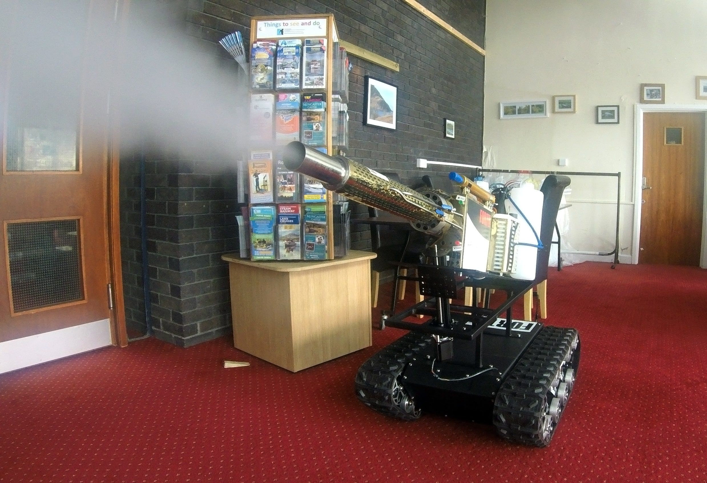 Forth's disinfecting robot being demonstrated in a reception area at Whitehaven Civic Hall-min (1).jpg