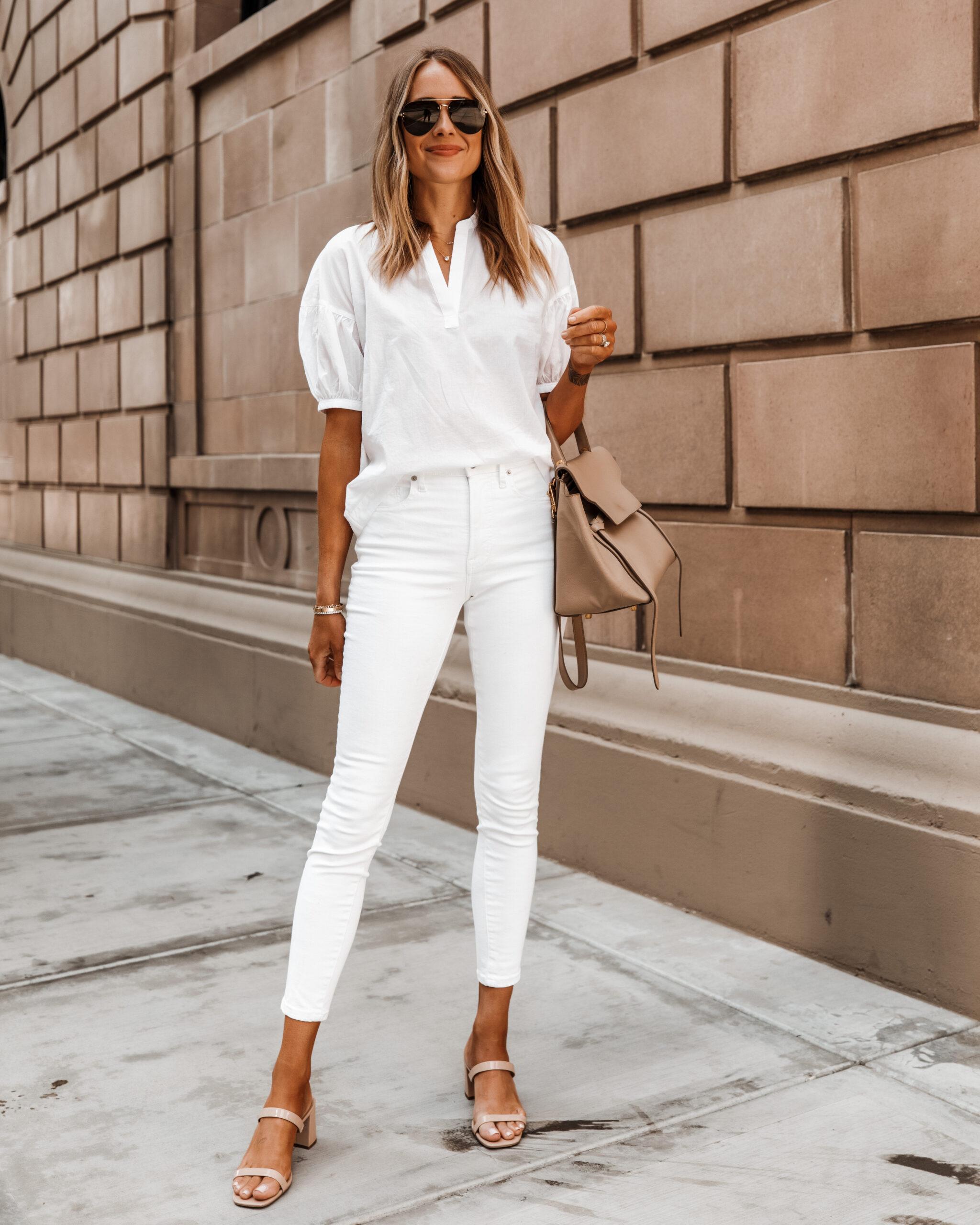Fashion Jackson Wearing Everlane White Puff Sleeve Top White Skinny Jeans Nude Sandals Celine Belt Bag