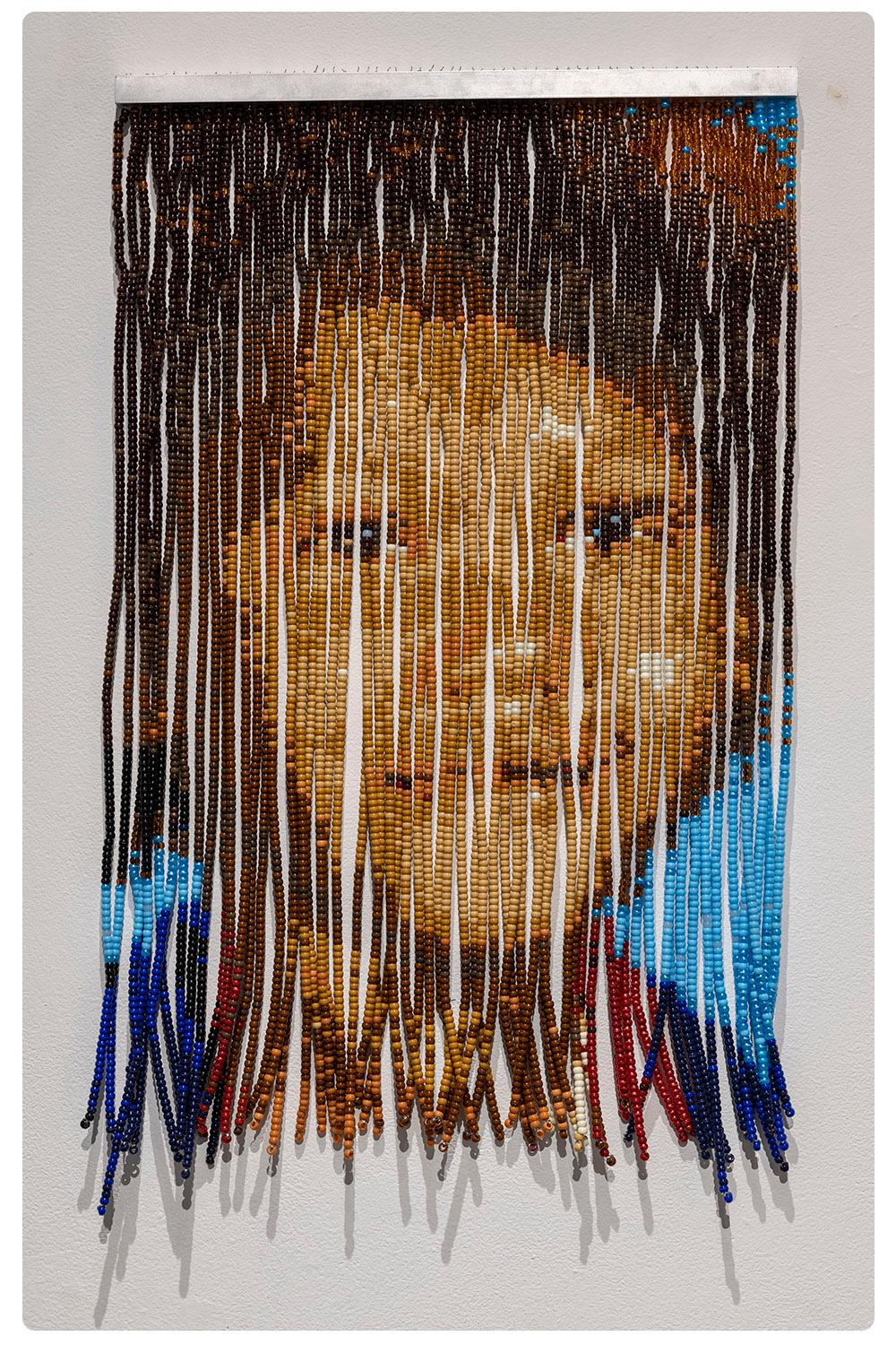 A portrait made out of beaded curtain