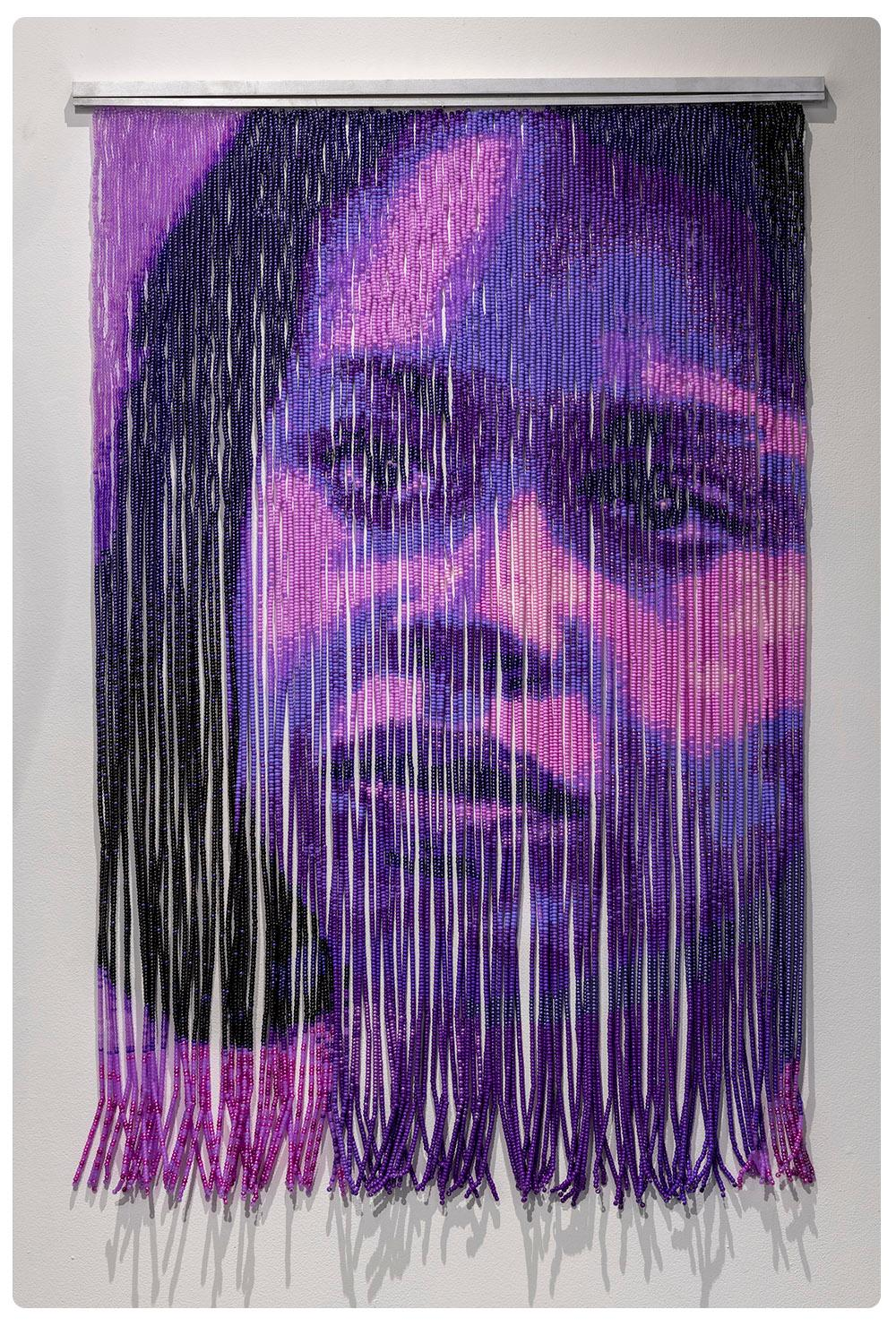 A portrait made from a purple beaded curtain