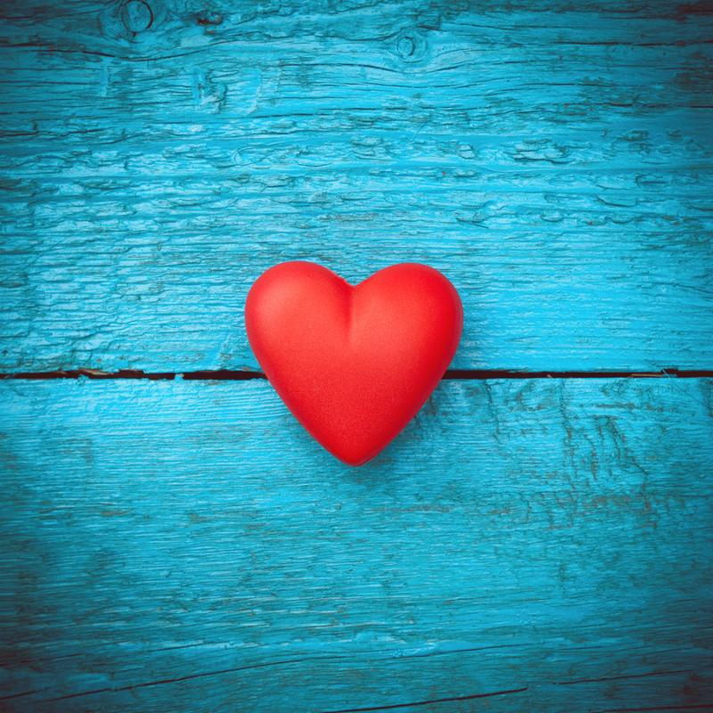 Valentine day. Red heart on the blue boards. Valentine s Day. Heart pendant. Red heart.  Space for text. Eighth of March. International Women s Day.