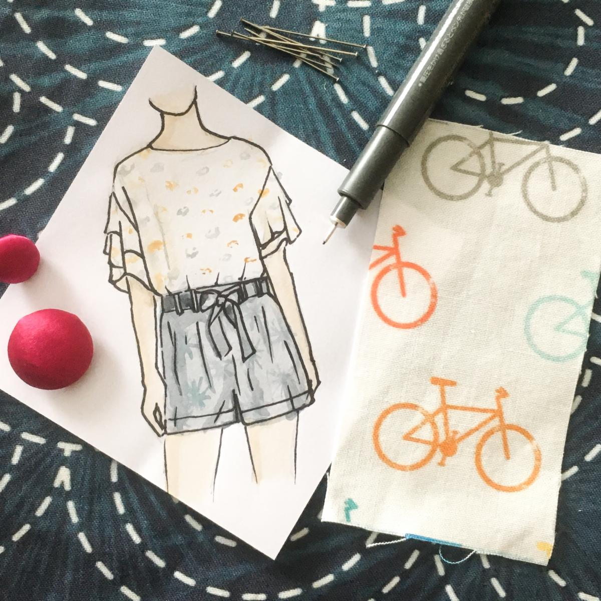 Flatlay of fabric button and sketch