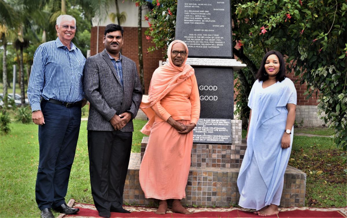 GOPIO Exec.VP Ramlutchman unveils Sivananda Peace Pillar