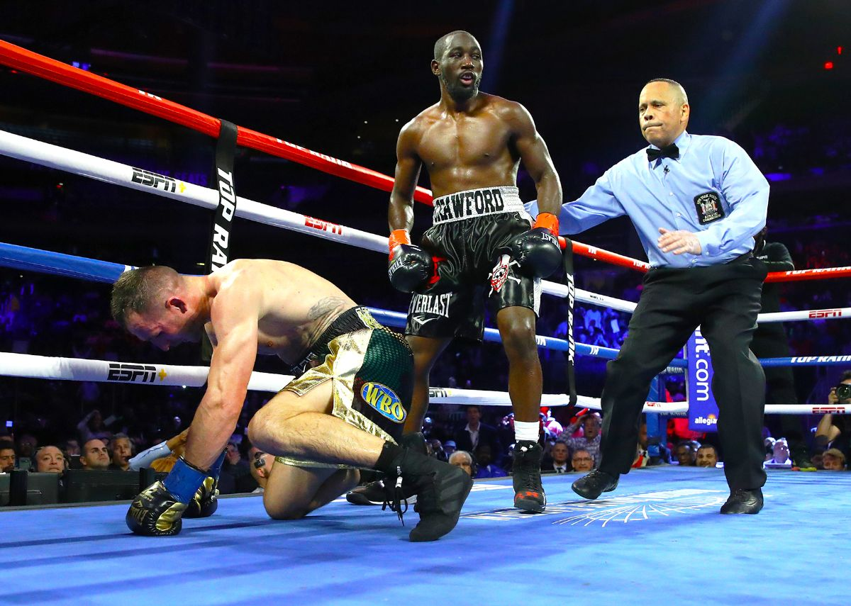 "Pound-for-pound king Terence ""Bud"" Crawford (R) knocks down ""Mean Machine""Kavaliauskas."