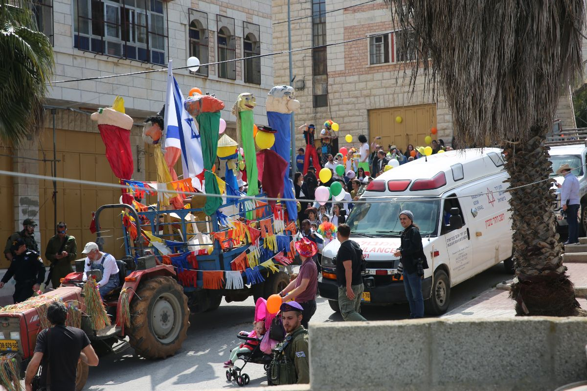 Image: Zionists celebrating the Jewish holiday of Purim (Photo: CPT)