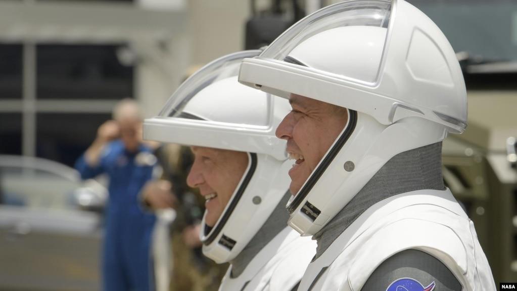 Astronauts Doug Hurley (left) and Robert Behnken on their way to SpaceX's Crew Dragon spacecraft.