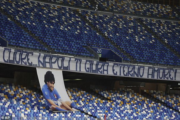 A banner reading in Italian 'Heart...Naples swears to you eternal love' to honor Diego Maradona is displayed in the stands prior to the Serie A soccer match between Napoli and Roma last night