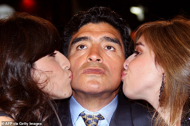 Maradona (C) is kissed by his daughters Giannina (L) and Dalma as he arrives to attend the screening of Serbian director Emir Kusturica's documentary film 'Maradona by Kusturica' at the 61st Cannes International Film Festival in Cannes in 2008