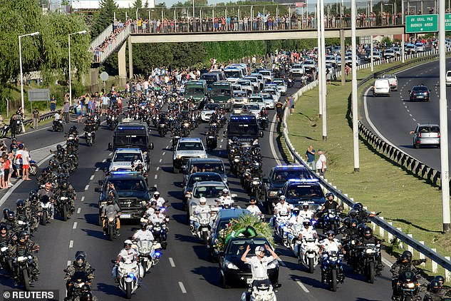 The hearse carrying his casket to the cemetery was watched by thousands of mourners