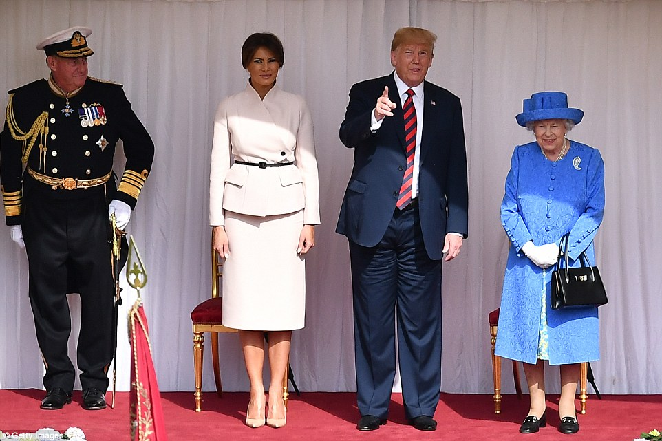 President Donald Trump and First Lady Melania stand in the Quadrangle with the Queen at Windsor Castle where they watched the Coldstream Guards parade