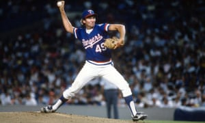 Charlie Hough of the Texas Rangers pitches against the New York Yankees in 1985. Hough enjoyed a 24-year pitching career and retired at 46.
