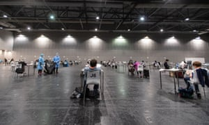 Passengers wait at a coronavirus testing centre in Hong Kong after arriving on a flight from overseas.