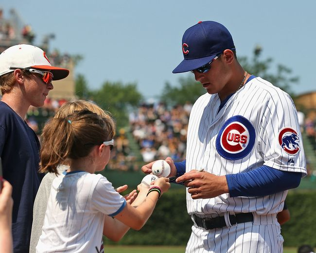 Image result for picture of a little girls getting an autograph from a baseball player