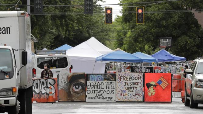 Seattle cuts deal with CHOP protesters to open some streets, make ...
