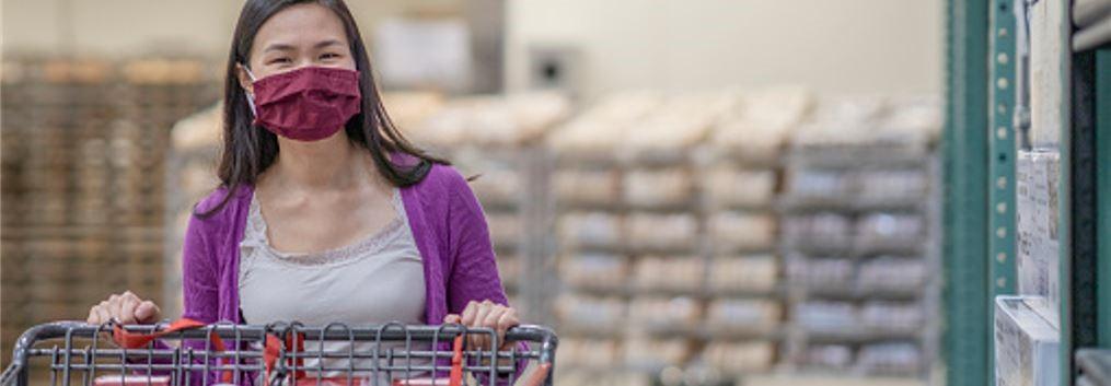 Woman wearing mask in supermarket